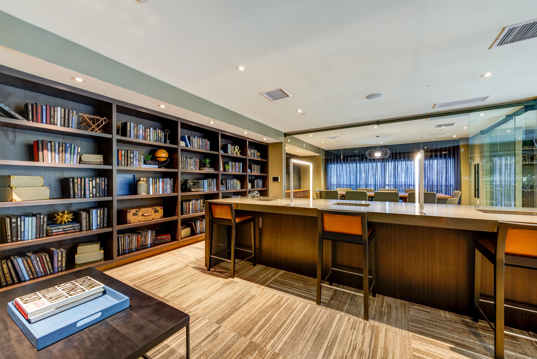 Interior of room with counter-height seating and book shelves