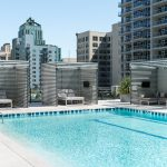 Exterior of rooftop pool with cabanas on pool deck
