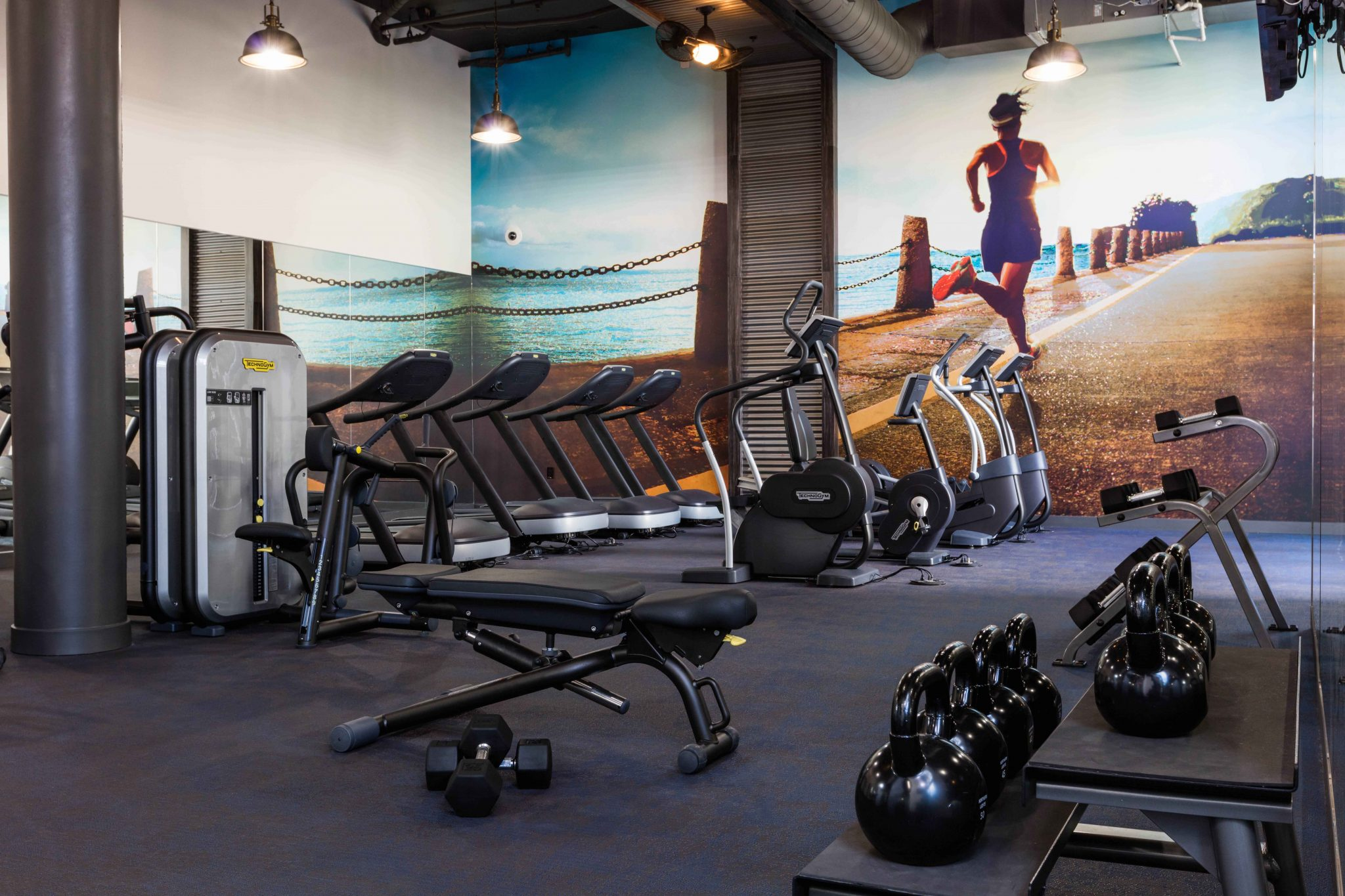Interior of fitness center with kettle bell weights and exercise machines