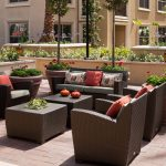 Outdoor seating area with chairs and tables.