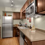 Galley kitchen with stainless steel appliances.