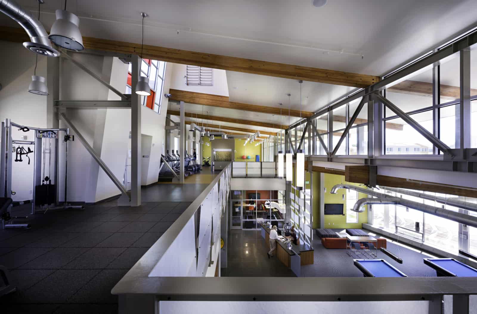 View of the second floor fitness center that's open to a common area below.