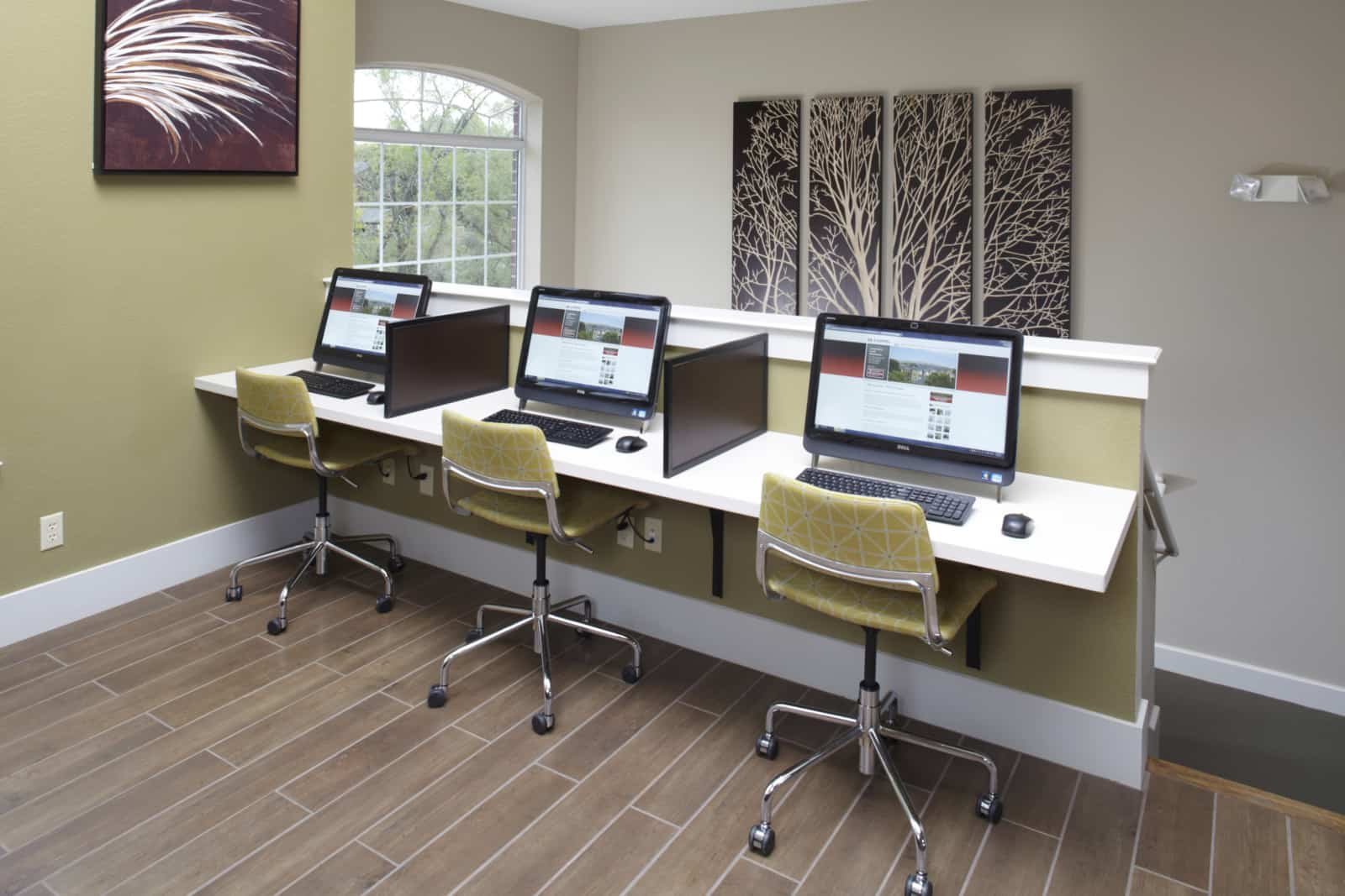 Business center with 3 computers in a row.