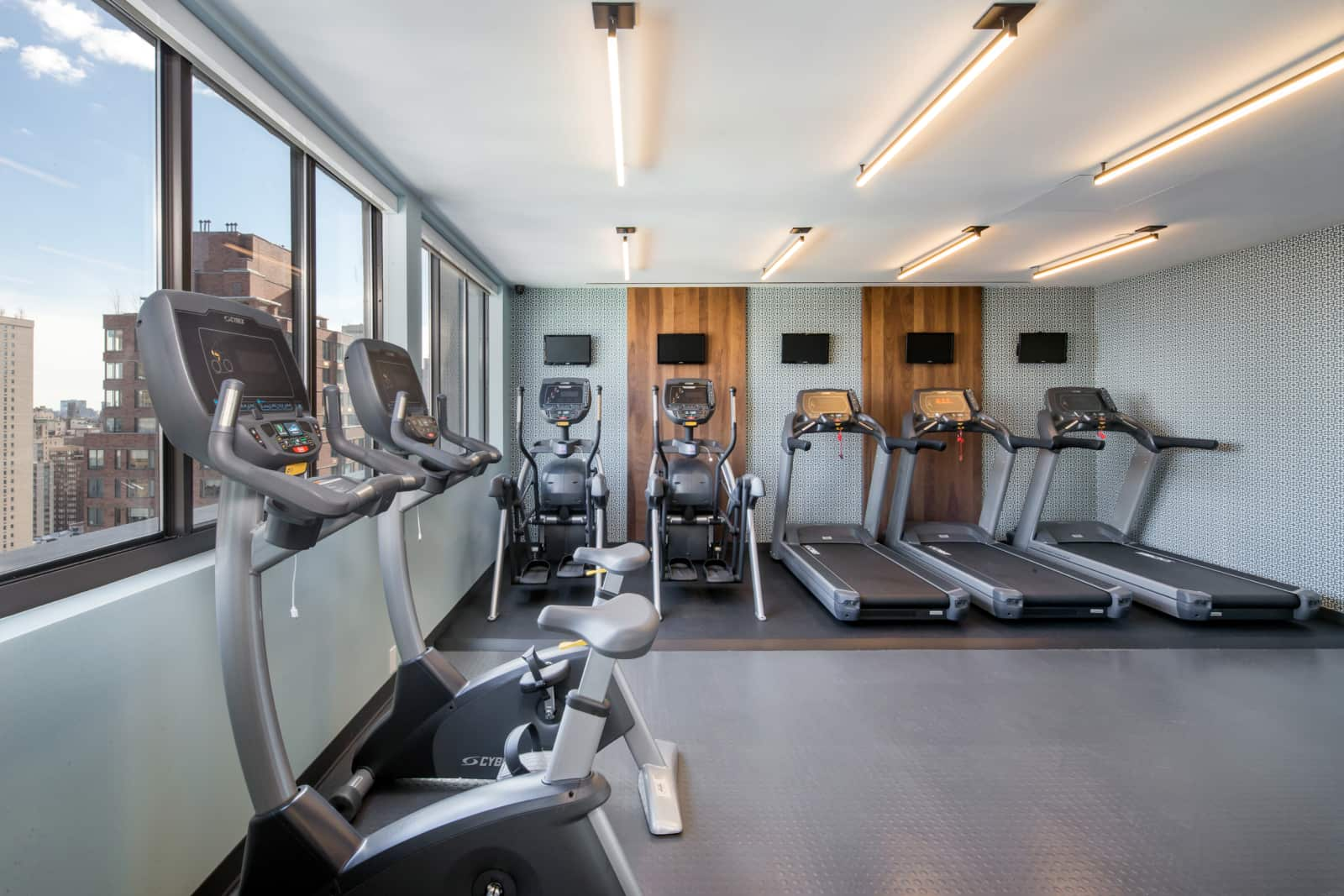 Interior of fitness center with various exercise machines.