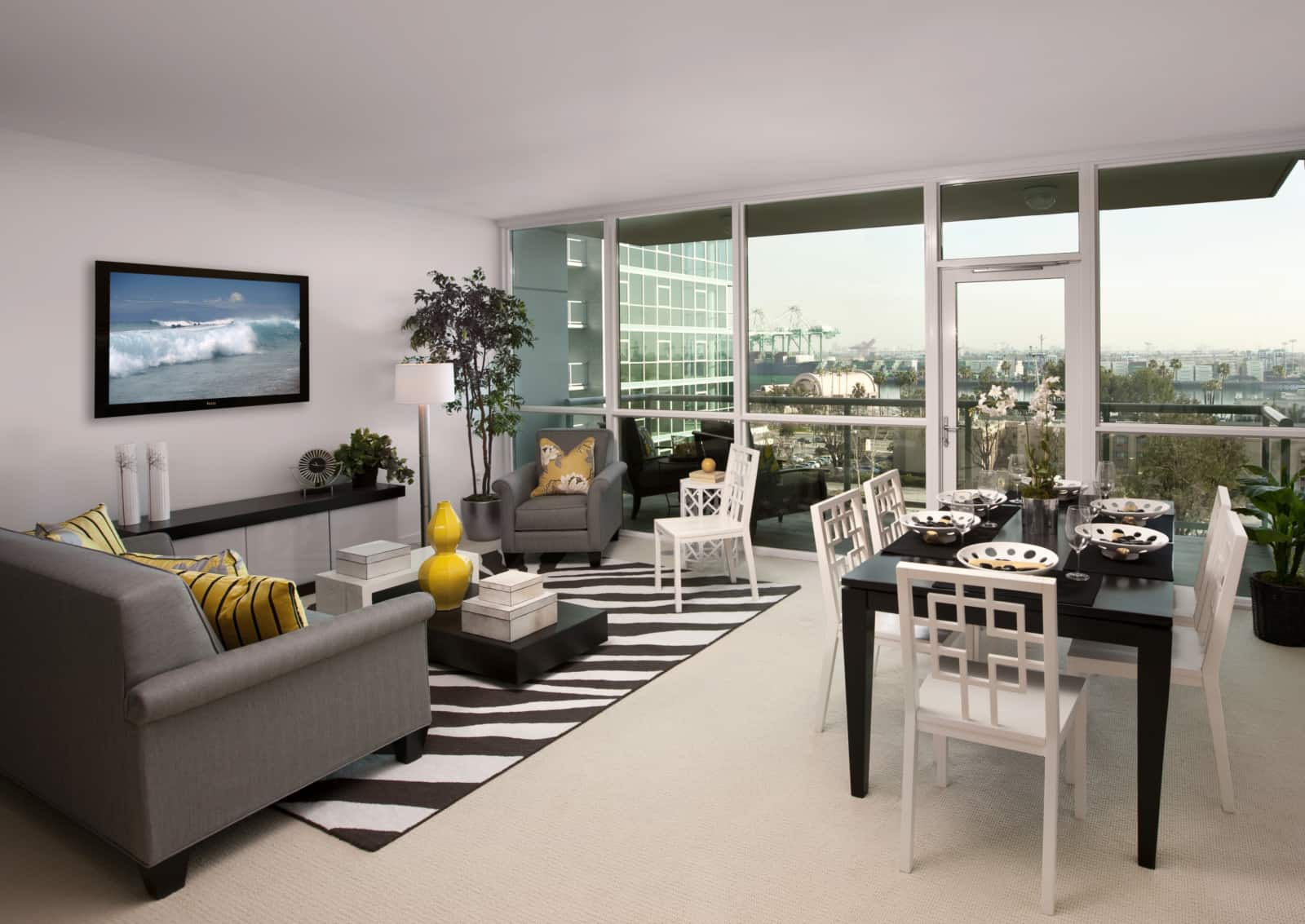 Interior of modern living room and dining area in a high-rise apartment.