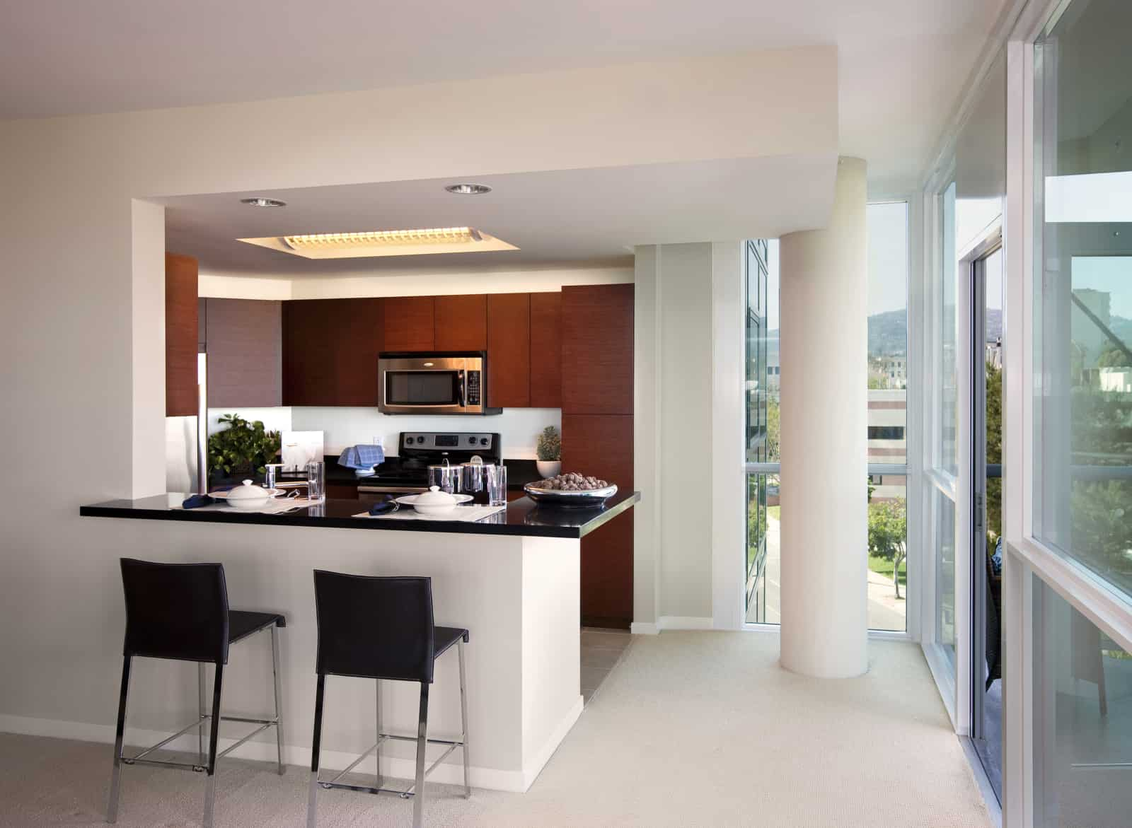 Interior of bar counter and kitchen in a high-rise apartment.