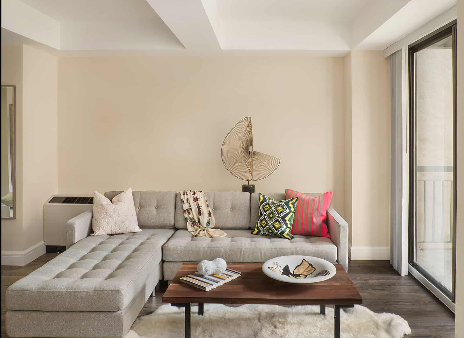Interior of apartment living room with modern couch and coffee table.