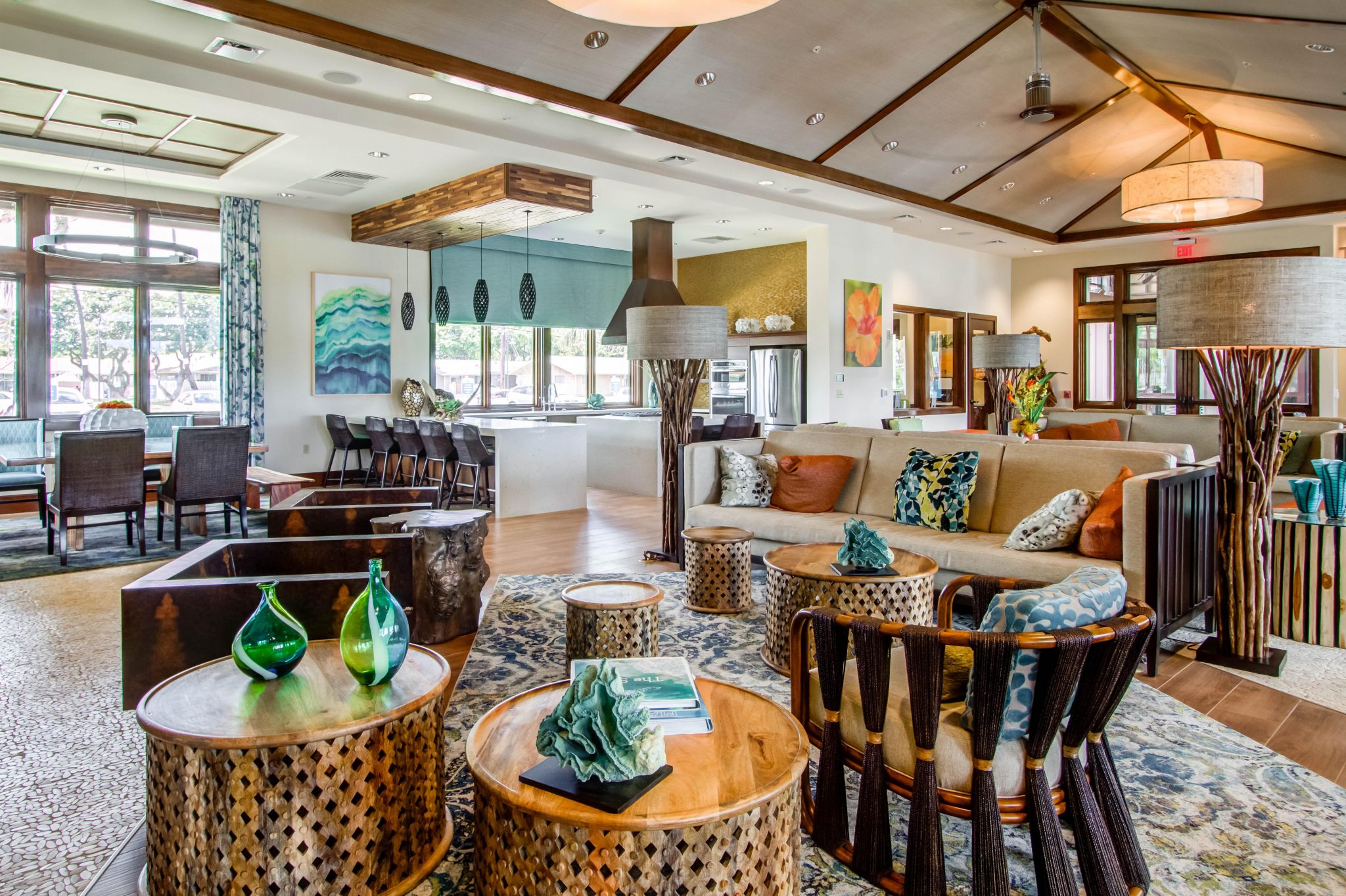 Interior of common area with couches, Polynesian furniture, and kitchen area in background.