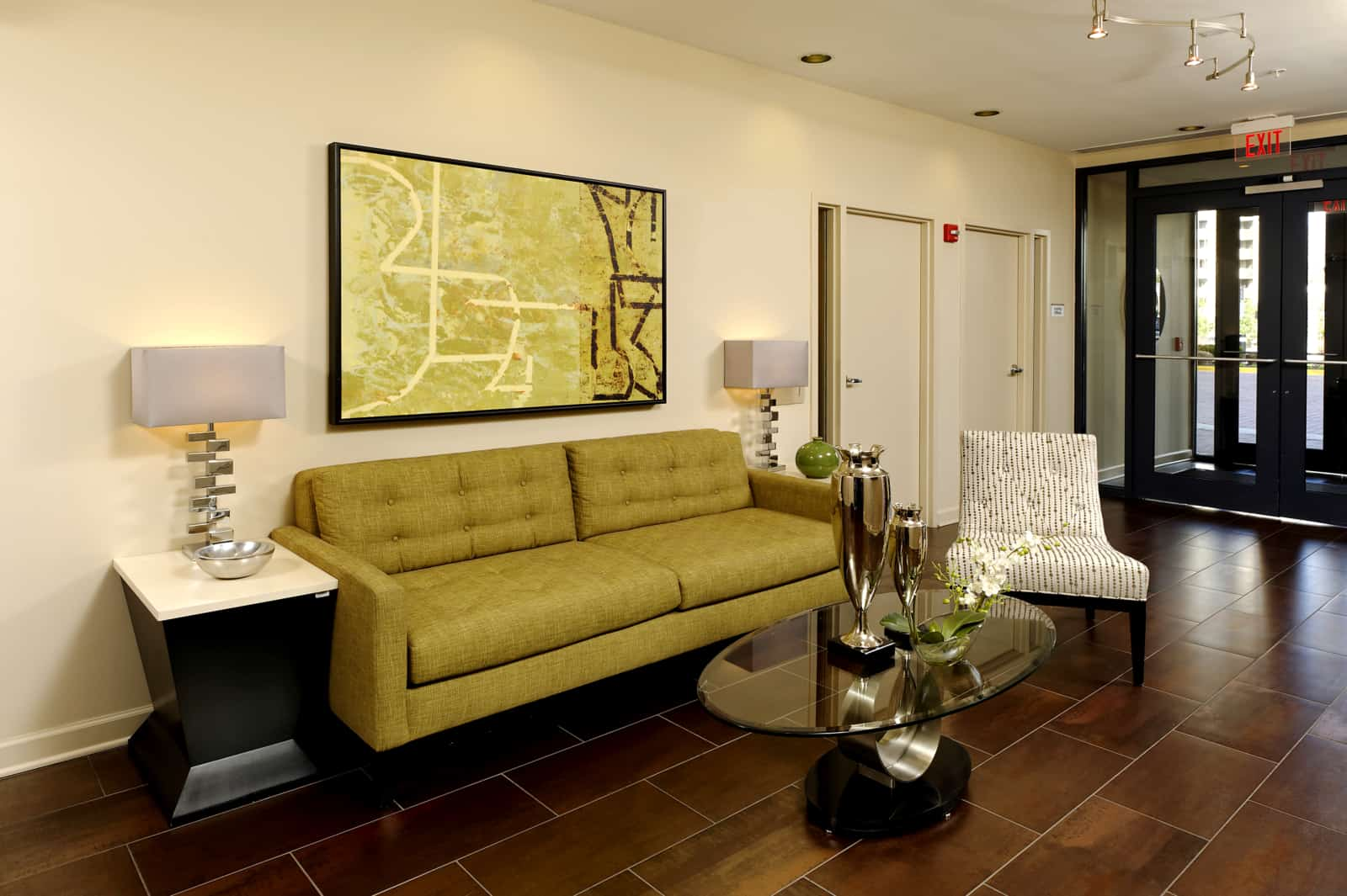 Interior of the lobby with couch, chair, coffee table and side tables.
