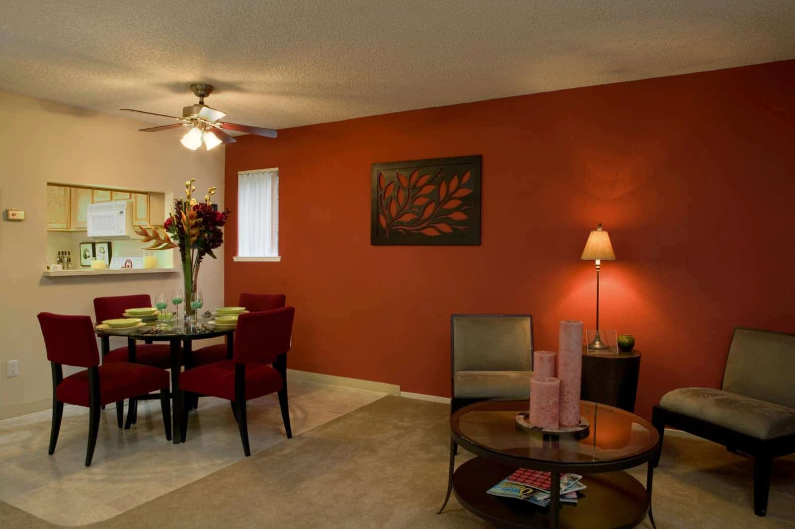 Interior of a living and dining room area and pass through to kitchen.