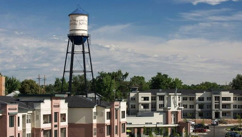 View of the top of the buildings with the water tower in the background.