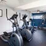 Fitness center with exercise equipment.