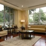 Interior of lobby with couch, chairs, coffee table, side tables, and lamps.