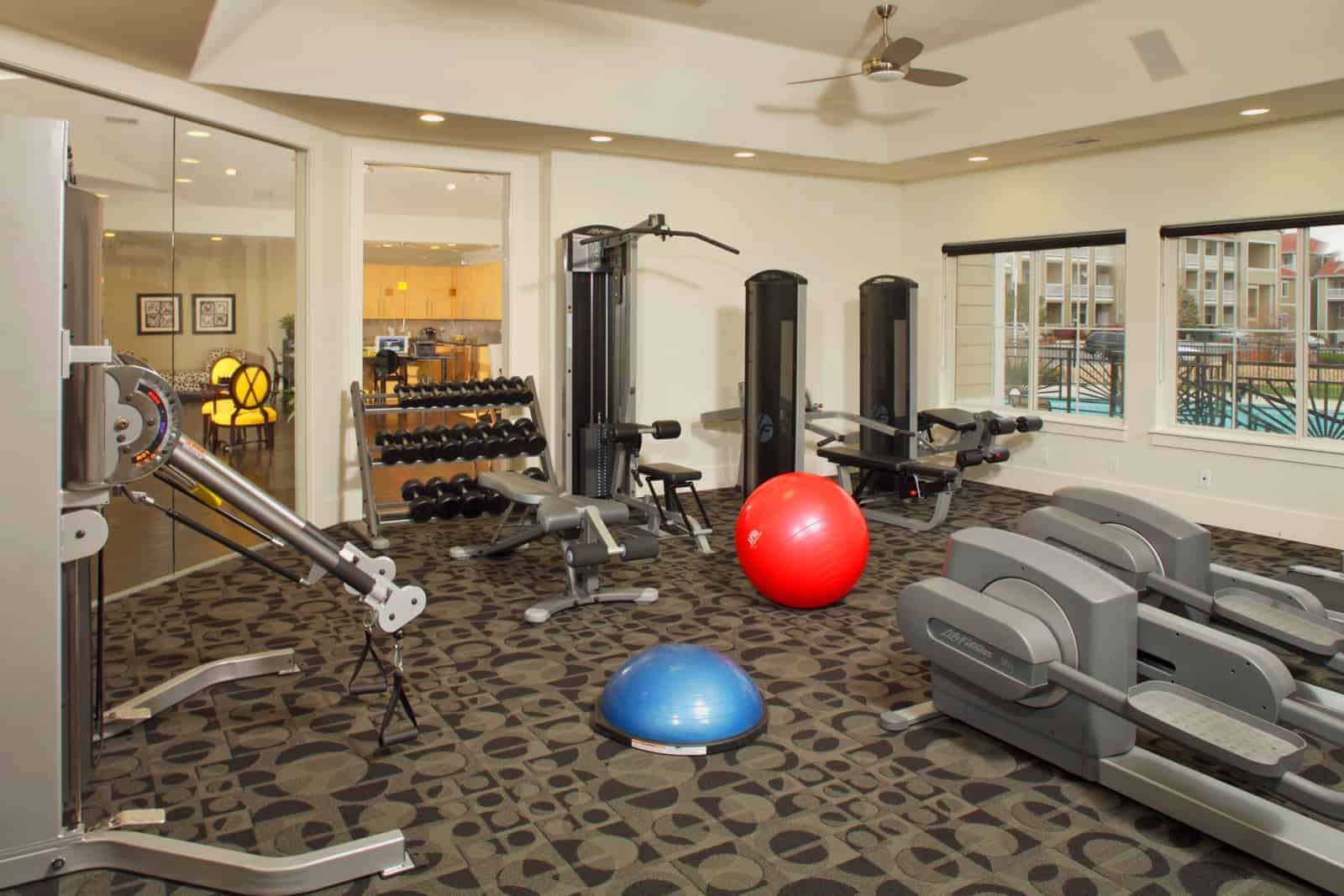 Fitness center with various exercise equipment.