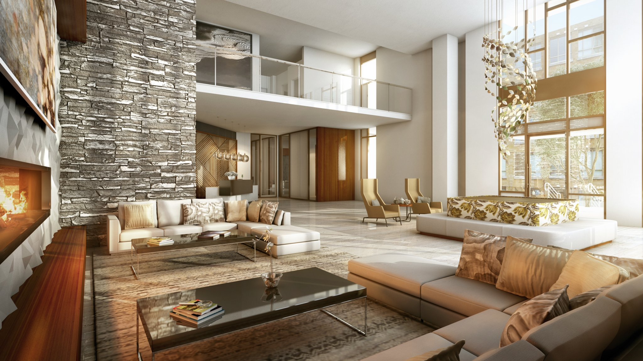 Interior of lobby with modern couches, fireplace, and rock wall
