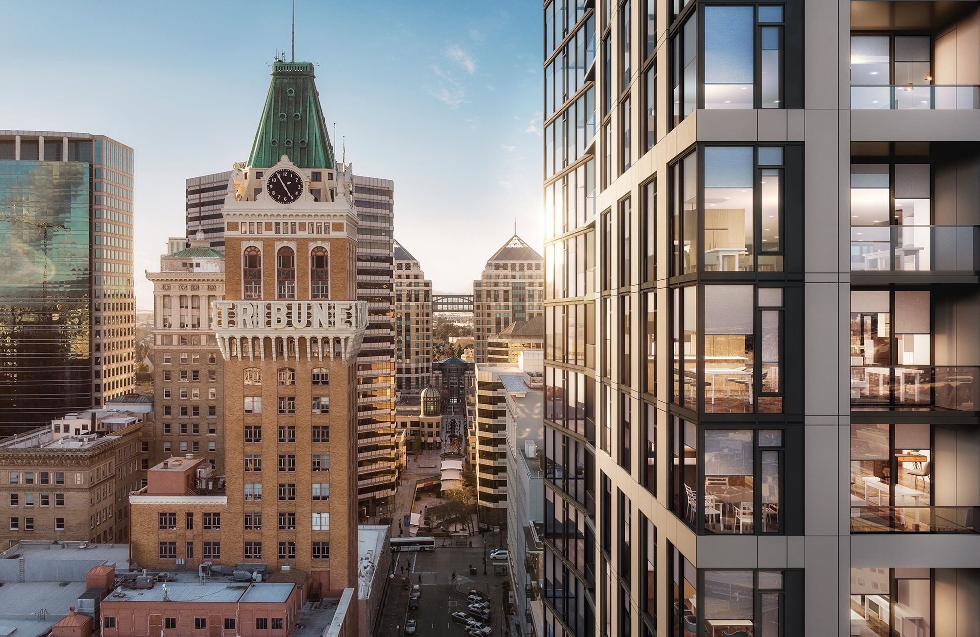 Exterior aerial view of apartment tower amidst other downtown Oakland buildings