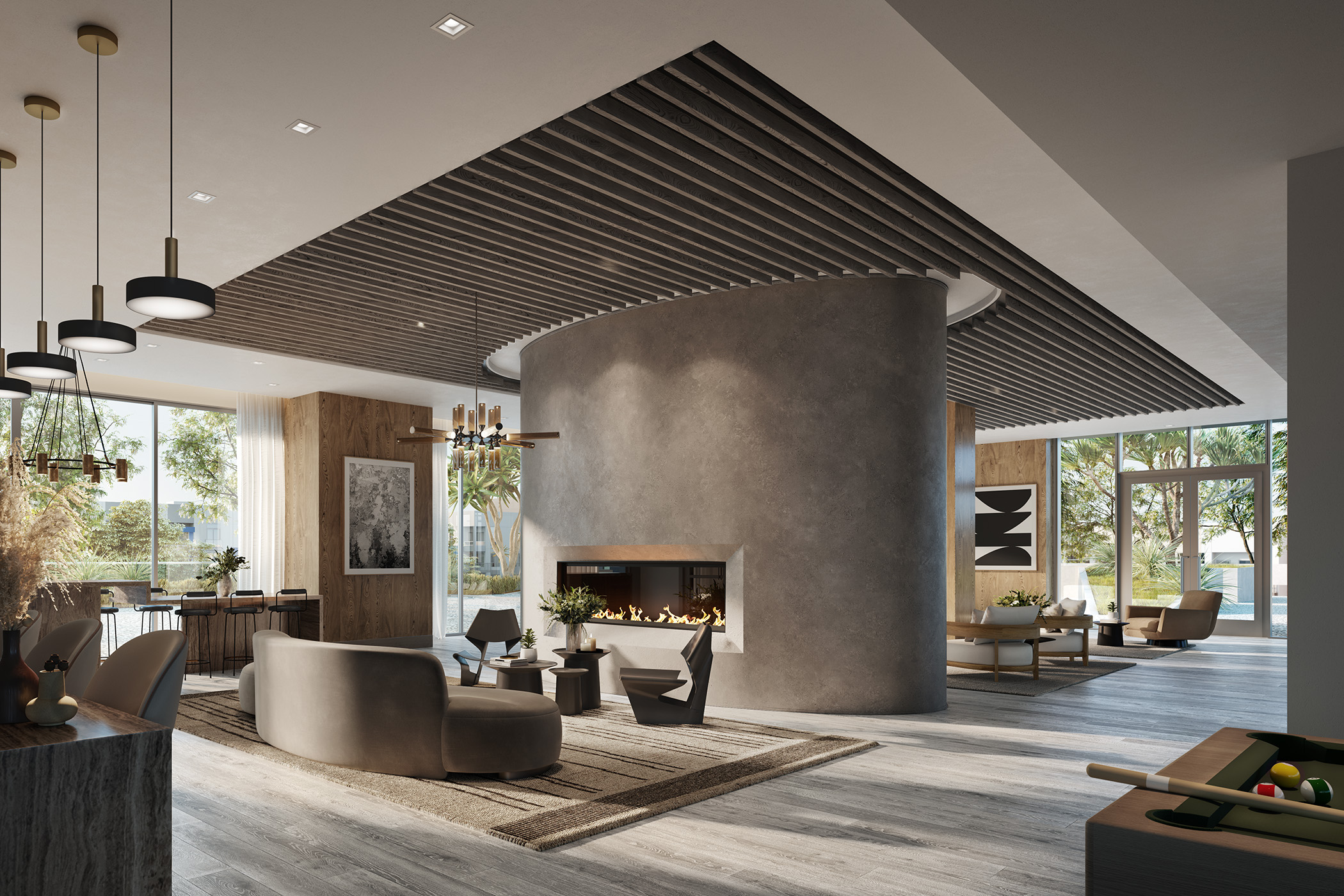 Interior of common space with modern fireplace, open seating with couches and chairs, and pool table.